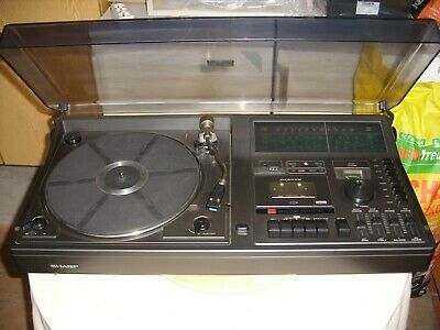 Sharp-SG-330H-Stereo-Music-Center-made-in.jpg.d118a2d005cd2d579825b8a4386314fd.jpg